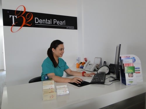A receptionist in T32 Dental Pearl