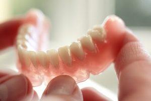 holding a denture