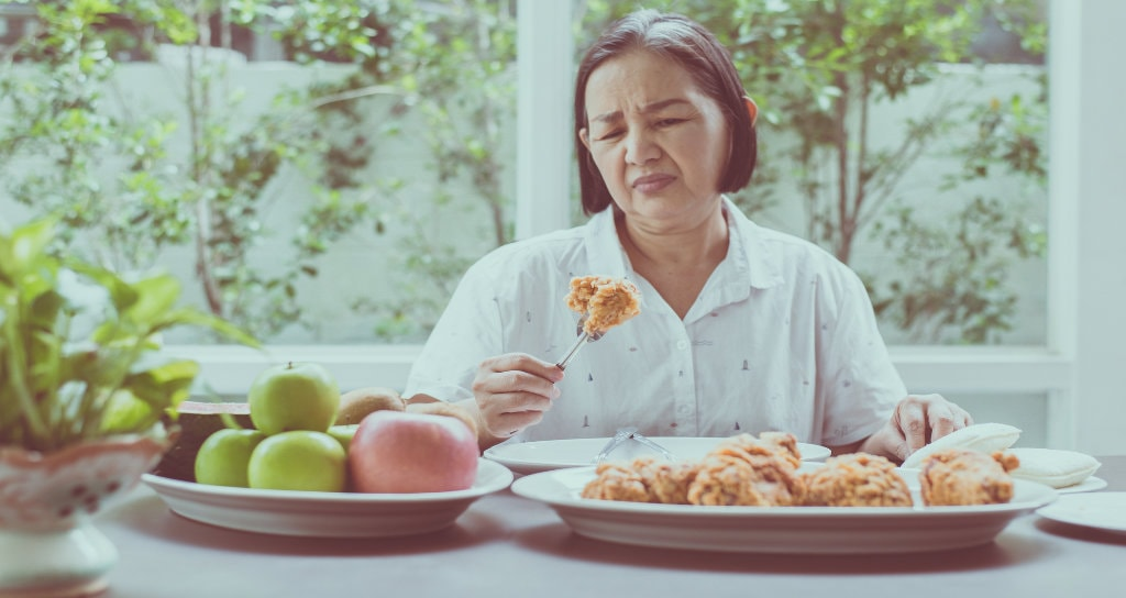woman upset when eating